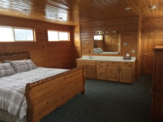 2nd Third floor master bedroom with private bathroom, including shower at Torch Lake Lodge.