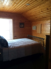 2nd of three second floor bedrooms at Torch Lake Lodge. View is of front of lodge.