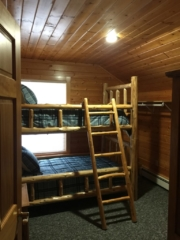 3rd of three second floor bedrooms at Torch Lake Lodge. View is of fire pit at back of lodge.