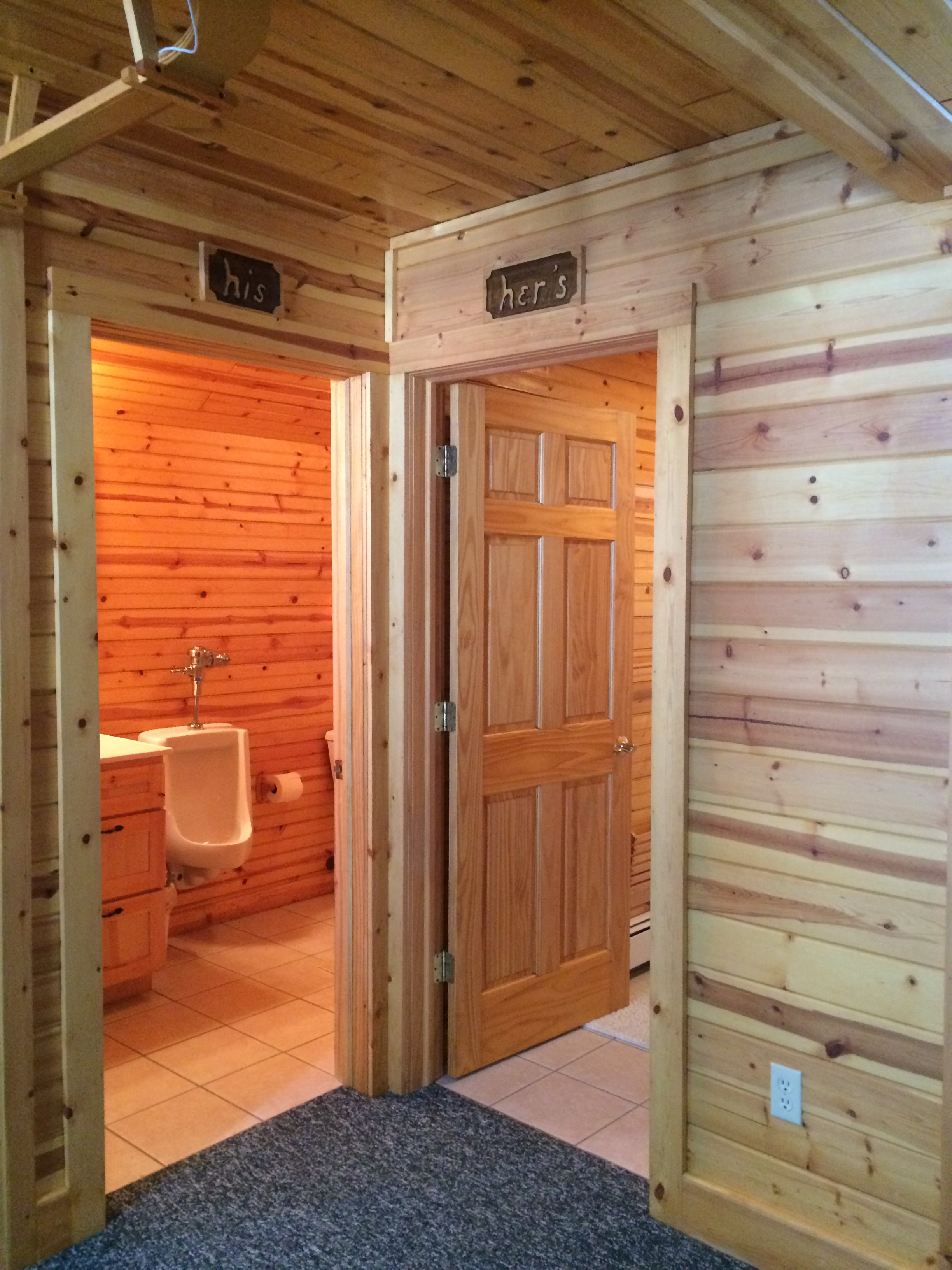 His and her's bathrooms on 2nd floor of Torch Lake Lodge. Both are full baths with showers.