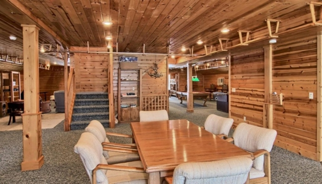 Dining area at Torch Lake Lodge, with stairs to two master bedrooms on next level.