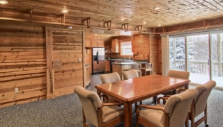 Dining and kitchen area at Torch Lake Lodge