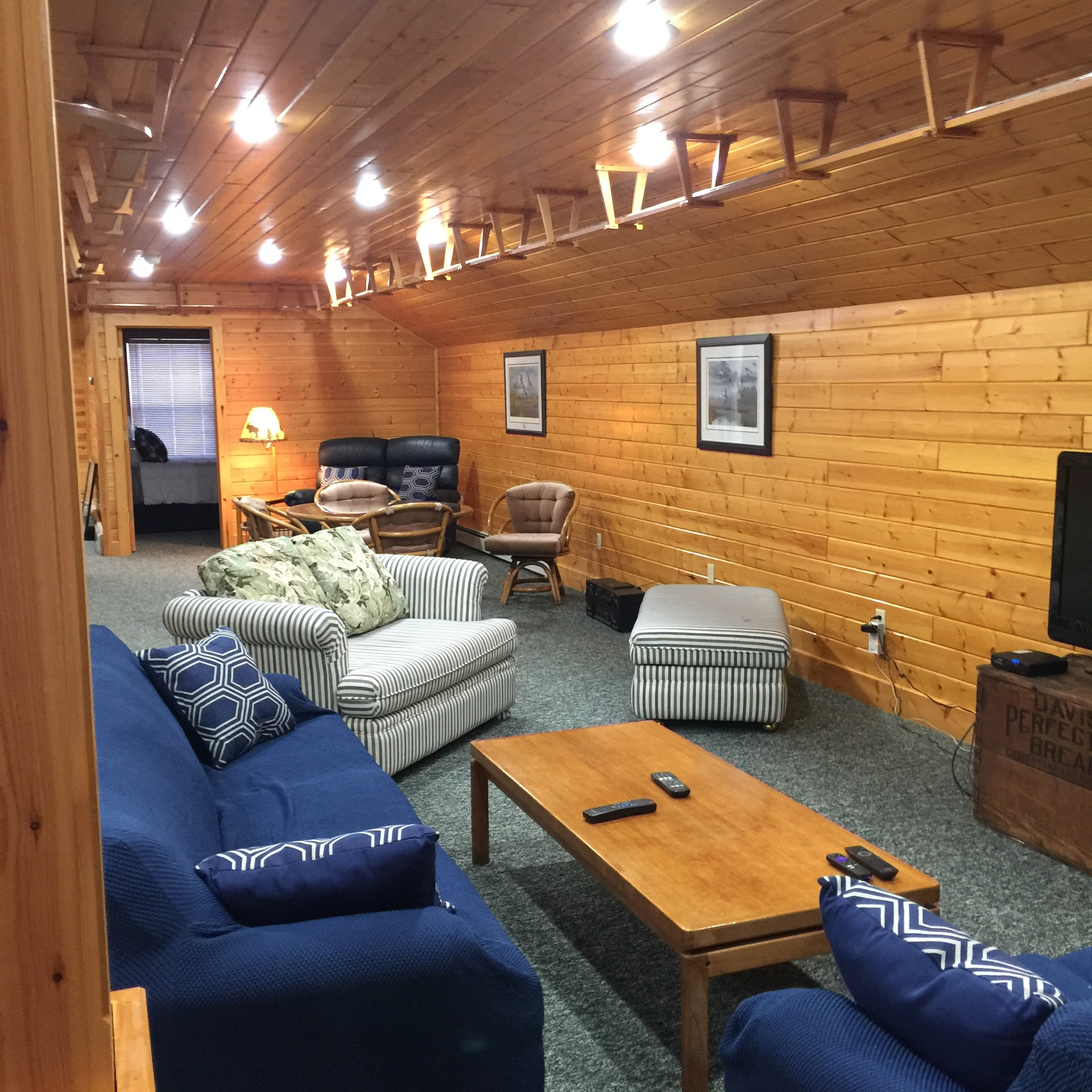 Seating area with cable TV at Torch Lake Lodge. All areas have high speed internet.