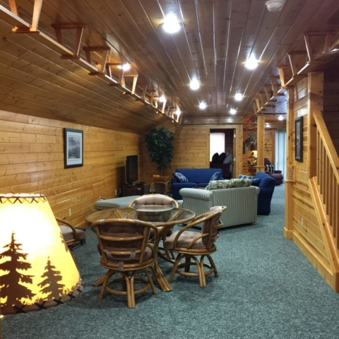 Seating area with cable TV at Torch Lake Lodge. All areas have high speed internet. Yes, there is an model train track around the entire 2nd floor. Train not included :).